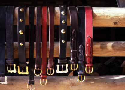 Leather Belts on Fence